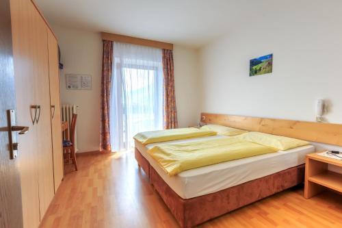 Ein Bett oder Betten in einem Zimmer der Unterkunft Gasthof Iris