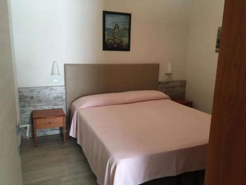 Un ou plusieurs lits dans un hébergement de l'établissement Hotel Splendid Mare