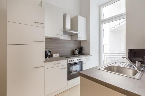 Kuchyň nebo kuchyňský kout v ubytování Gemütliche Wohnung mit Terrasse im Zentrum