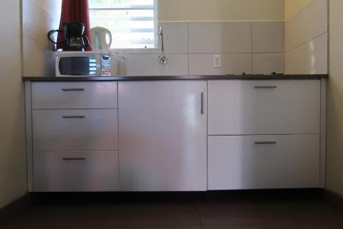 A cozinha ou cozinha compacta de Cattleya Apartments Curacao