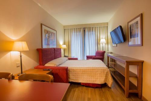 Ein Bett oder Betten in einem Zimmer der Unterkunft Aparthotel Shusski
