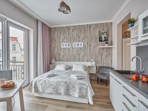 Postel nebo postele na pokoji v ubytování WITH LOVE Marienbad Ap. Dvorakova