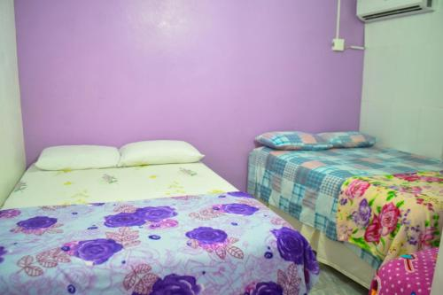 A bed or beds in a room at Hospedagens São Borja RS