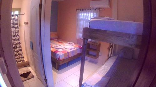 A bunk bed or bunk beds in a room at Surfari Bocas