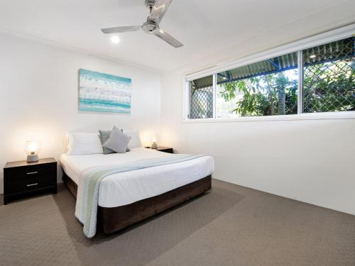 A bed or beds in a room at Diamond Beach 3 Bedroom Poolside Apartment