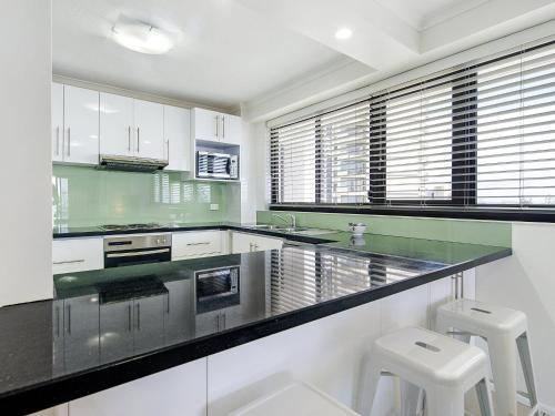 A kitchen or kitchenette at South Pacific Dream, Central Broadbeach