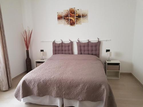 """A bed or beds in a room at Appartamento""""Alba"""""""