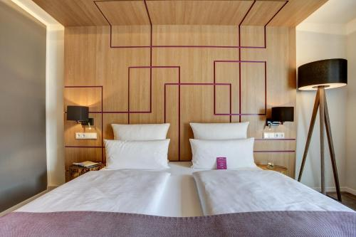 A bed or beds in a room at FourSide