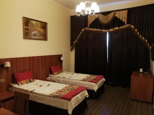 Кровать или кровати в номере Mini-hotel Saltykovskaya