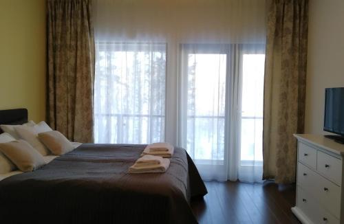 Säng eller sängar i ett rum på Marina Holiday Rauhan Village