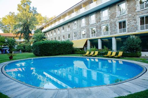 The swimming pool at or near Hotel Grao Vasco