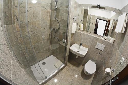 Kúpeľňa v ubytovaní Alexandra Šport Hotel