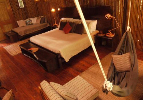 A bed or beds in a room at Refugio Amazonas Lodge