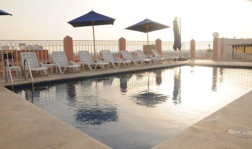 The swimming pool at or near Hôtel Racine