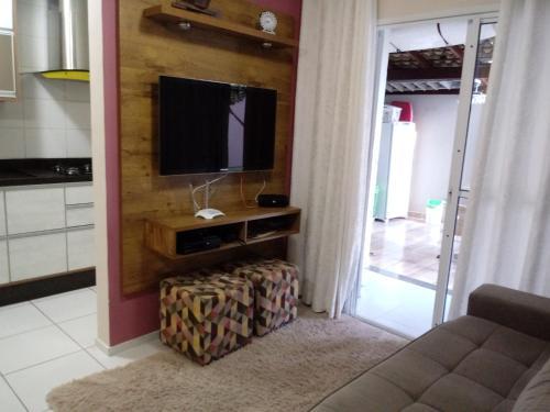 A television and/or entertainment center at Espaço Relax em condominio clube