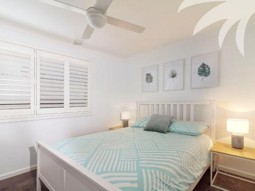 A bed or beds in a room at Seascape 1 @ Blueys