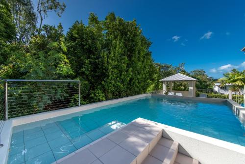 The swimming pool at or near Candlelight - Airlie Beach