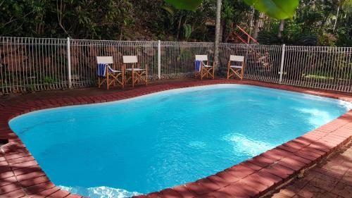 The swimming pool at or near Beach House on Begley - Airlie Beach Central
