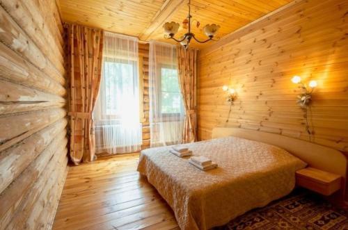 Кровать или кровати в номере Дом Отдыха ВКС-Кантри