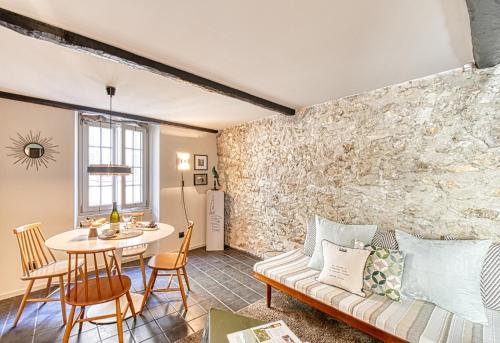 A seating area at Amazing Chic Apt in Le Suquet by GuestReady