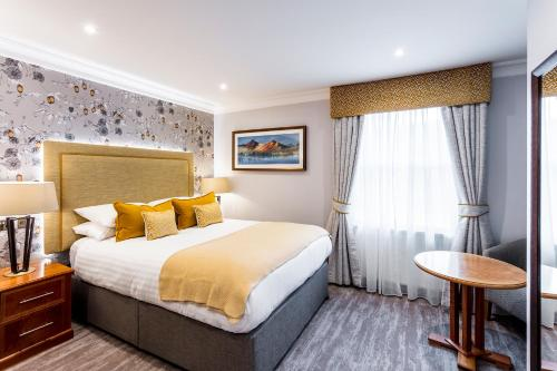 A bed or beds in a room at The Borrowdale Hotel
