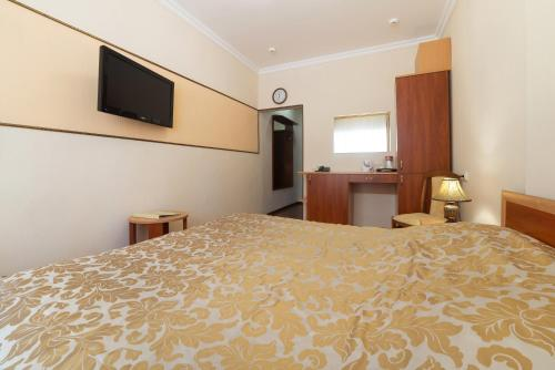 A bed or beds in a room at Sanatoriy Tsentrosoyuz Kislovodsk