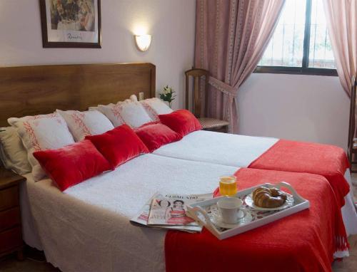 Кровать или кровати в номере Hotel Praderón