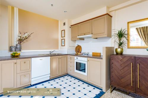 A kitchen or kitchenette at OGB Suites