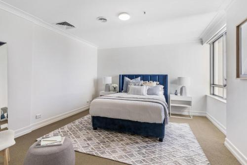 A bed or beds in a room at Live the harbourside life