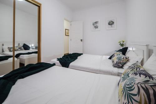 A bed or beds in a room at Lisbon two bedroom apartment with balcony