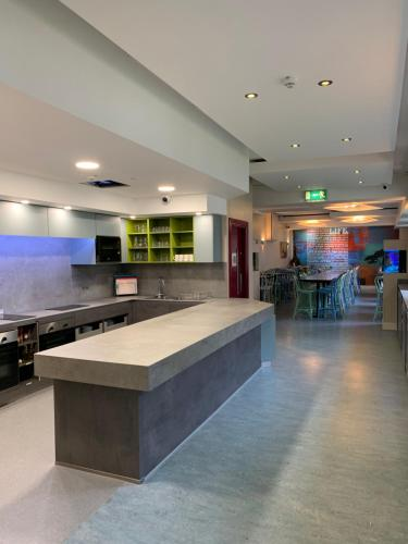 A kitchen or kitchenette at Kinlay House Eyre Square Hostel