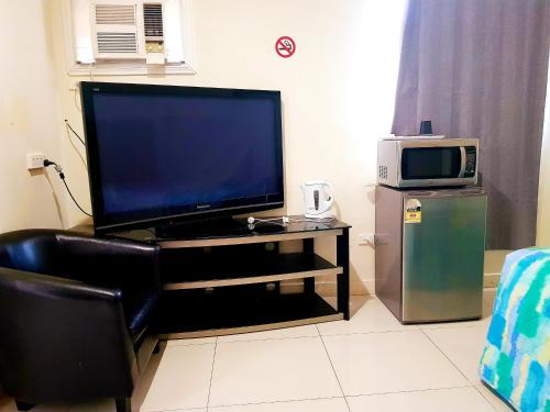 A television and/or entertainment center at Perth City Motel