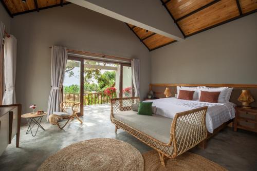 Кровать или кровати в номере M Resort & Spa Phu Quoc