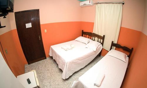 A bed or beds in a room at Hotel Minas Brasil