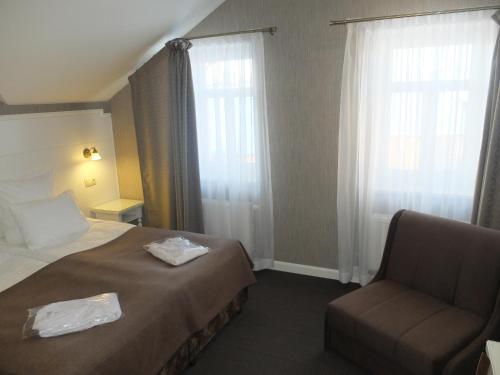 Кровать или кровати в номере Усадьба Веранда