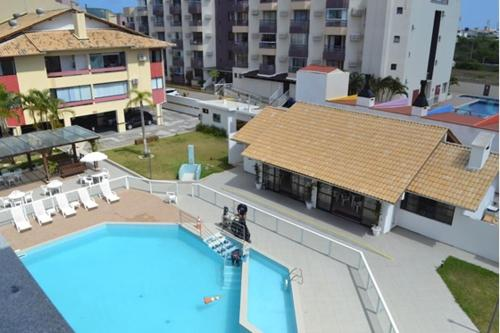 A view of the pool at APT 30 M DA PRAIA C/ PISCINA E WIFI or nearby