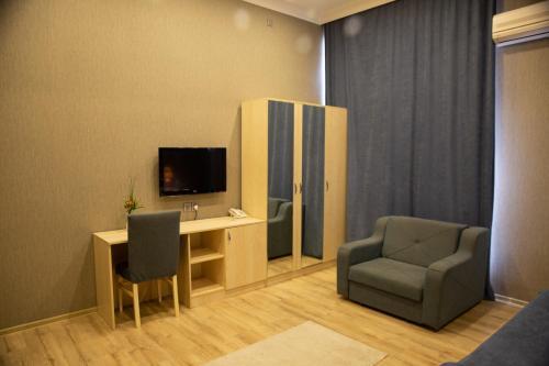 A television and/or entertainment center at Life Holiday Baku