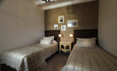 A bed or beds in a room at El Cortijo Hotel Boutique