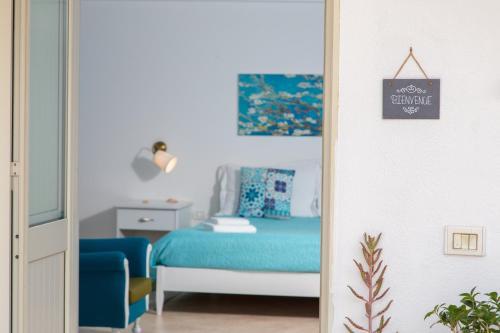 A bed or beds in a room at Le Terrazze di Pirandello