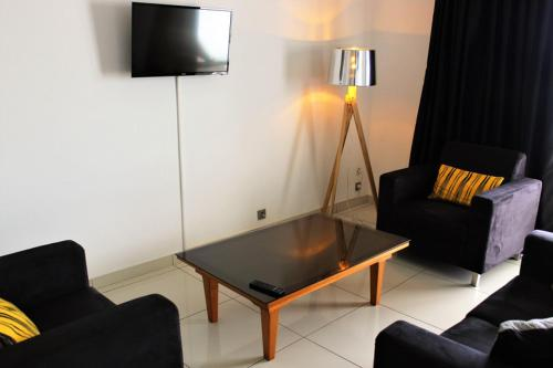 A television and/or entertainment center at Casa Del Sole Apartments