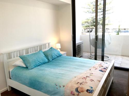 A bed or beds in a room at Kiama Executive