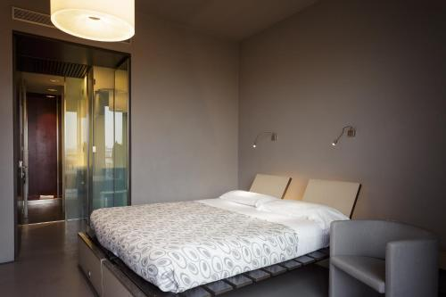 A bed or beds in a room at Hotel Verona