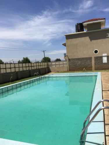 The swimming pool at or near KRis place