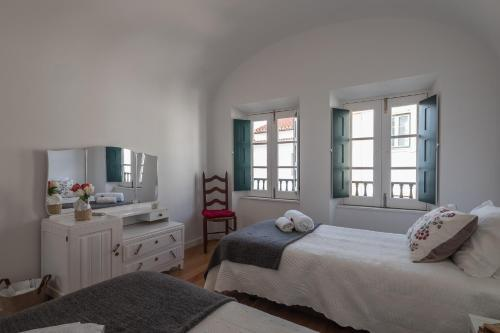 A bed or beds in a room at Home at Évora's Main Street