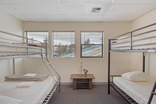 A bunk bed or bunk beds in a room at San Juan Island Hostel