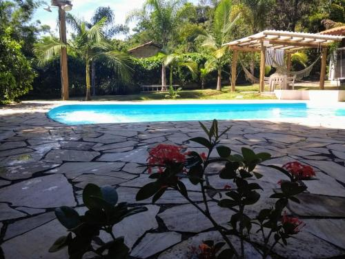 The swimming pool at or near Chácara do Delei
