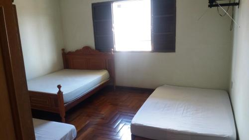 A bed or beds in a room at Casa para Carnaval