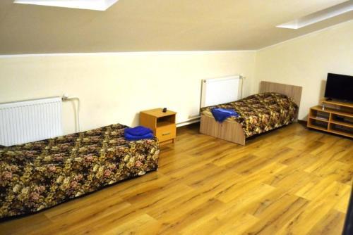 Кровать или кровати в номере Гостевой дом Апарт-Руза