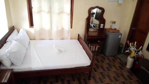 Кровать или кровати в номере Farm Belle Cottages