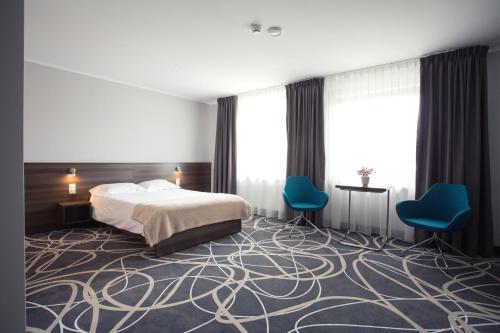 Łóżko lub łóżka w pokoju w obiekcie Hotel Nad Nettą
